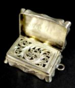 A Victorian silver vinaigrette, of shaped rectangular form, with wave engine turned decoration to