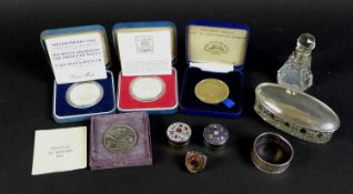 A collection of silver items and coins, including two dressing table items, a scent bottle with