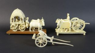 Two 19th century Indian ivory carvings, one of a howdah with two occupants being pulled by a pair of