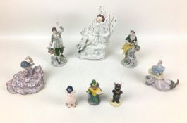 A group of English and Continental figurines, comprising a 19th century Staffordshire flatback