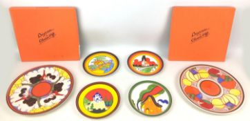 A group of four Wedgwood Clarice Cliff Bizarre reproduction plates and two boxed chargers,