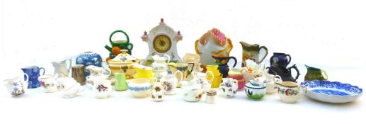A large group of decorative ceramics including an Austrian clock in the rococo style, decorated with