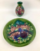 Two pieces Moorcroft pottery with finch and berry design by Sally Tuffin on green ground, comprising