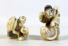 Two Japanese Meiji Period ivory katabori netsuke, one of a man playing with a child using a large
