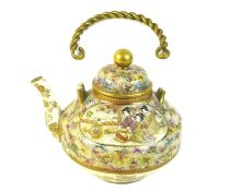 A fine Japanese Satsuma pottery teapot, Meiji period, with gilt metal swing handle, finely painted