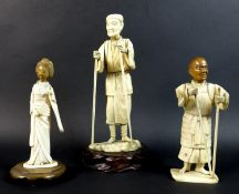 A group of three late 19th /early 20th century ivory okimonos, comprising a figure of an elder, with