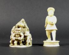 A Meiji period ivory netsuke, formed as a cart being pulled by a demon, with three further