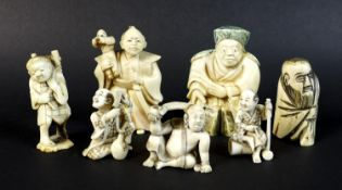 A group of Japanese Meiji period ivory figures comprising three netsuke, one of a gentleman with a