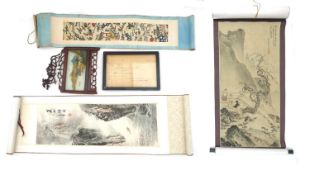 A Japanese scroll painting or Kakemono, depicting figures in a mountainous landscape,138 by 49cm,