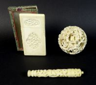 A group of three late 19th / early 20th century Chinese ivory items comprising a card case, the