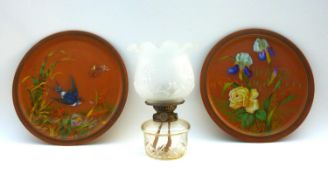 A pair of Watcombe Torquay terracotta chargers, one decorated with a swallow flying amongst reeds
