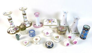 A pair of Crown Staffordshire hand painted candlesticks, decorated with pink rose-buds and swirls of
