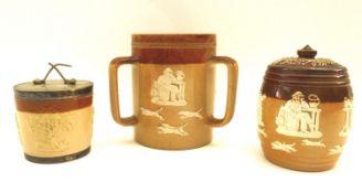 A Royal Doulton Lambeth ware tyg, 15cm high, together with a Doulton Lambeth ware tobacco jar 14.5cm