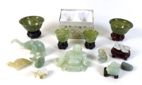 A collection of modern jade and hardstone ornaments, including two pairs of cups, and various carved