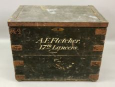 A black painted metal bound wooden military chest, Saddlery from Whippy, Steggall & Co,