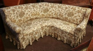 A large curved upholstered wing back set
