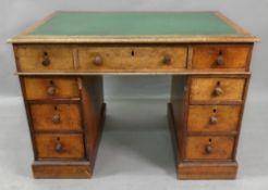 A late Victorian oak kneehole desk, the