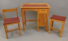 A child's Taylor light wood desk, 69cm w