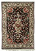 A Ghom silk rug, with a central floral m