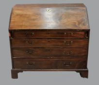 A George III mahogany bureau, the hinged