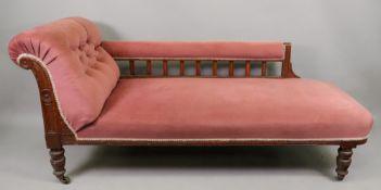 An Edwardian oak frame chaise longue, bu