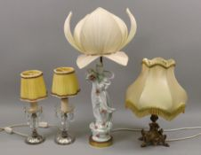 A modern Chinese porcelain figure of guanyin, mounted as a table lamp with lotus flower shade,