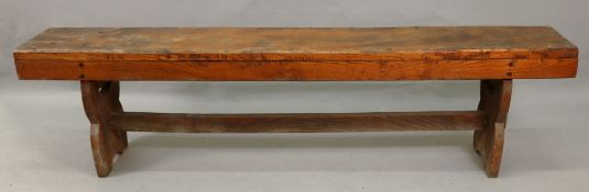 A pair of narrow elm benches, 20th centu