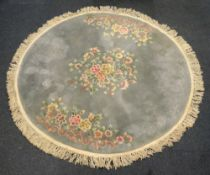 A washed Chinese circular carpet, floral