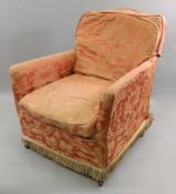 An Edwardian upholstered armchair, on sq