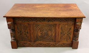 A reproduction foliate carved oak coffer