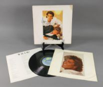 Wham ! Make It Big vinyl record, the sleeve signed by George Michael & Andrew Ridgley.