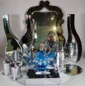 A group of three mirrored vases, 50cm high and a group of four 20th century chromed pots,