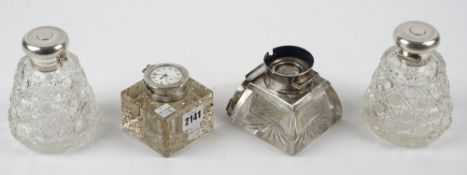 A silver mounted square glass inkwell, Birmingham 1911, the top mounted with a keyless wind,