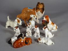 Royal Doulton; a group of ten various dog finials, the largest 14cm high, (10).