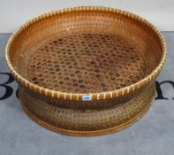 A mid-20th century rattan basket weave low table.