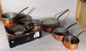 A quantity of 19th century copper pots and pans, (qty).