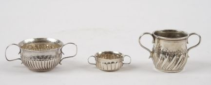 A silver twin handled miniature porringer, with semi-fluted decoration,