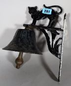 A cast iron doorbell with black cat decoration, 29cm high.