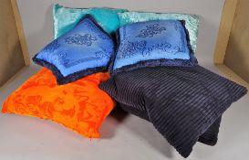 Versace; a pair of blue silk cushions, 40cm wide,