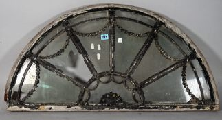 An 18th century and later demi-lune window panel, 92cm wide x 48cm high.