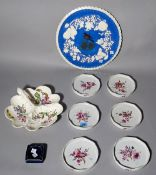 A set of six Thuringian porcelain bottle coasters painted with flowers,