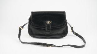 A Gucci style black leather ladies handbag with gilt metal hardware and adjustable shoulder strap,