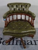 A 20th century hardwood framed office open armchair with button back green leather upholstery,