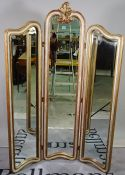 A modern gold painted triptych floor standing mirror, 120cm wide x 165cm high.