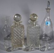 A glass decanter with engraved label, 'White', two square glass spirit decanters,