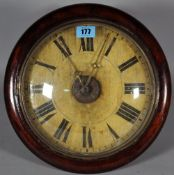 An early 20th century postman's wall clock with stained pine case, 30cm diameter.