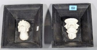 Two 20th century plaster heads within black painted pine frames, 16cm wide, (2).