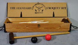 Townsend Croquet; a 20th century cased croquet set, 108cm wide x 17cm high.