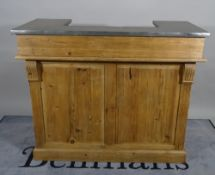 A 20th century pine bar with arrangement of shelves and wine racks,