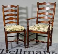 A set of eight 18th century style ash ladderback dining chairs to include two carvers,